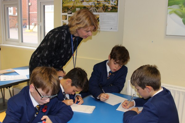 Lower School engage with teacher in class lesson