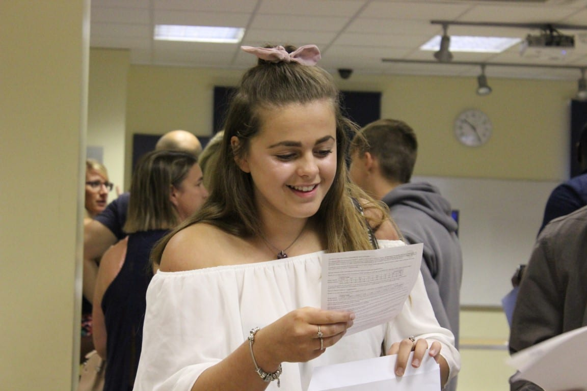 Happy GCSE pupil receives great exam results